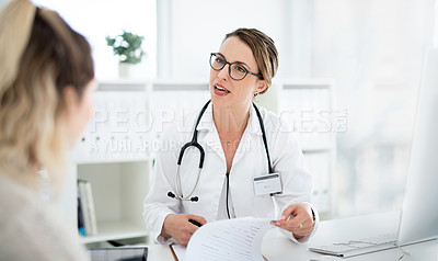 Buy stock photo Cropped shot of an attractive young female doctor consulting with a patient inside her office at a hospital
