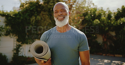 Buy stock photo Cropped portrait of a happy senior man standing alone before a yoga session in his back garden