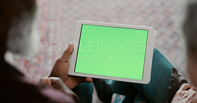 Buy stock photo Cropped shot of an unrecognizable couple bonding and using a tablet during a day off in their home