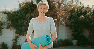 Buy stock photo Cropped portrait of a happy senior woman standing alone before a yoga session in her back garden