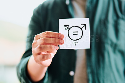 Buy stock photo Cropped shot of unrecognizable man holding a piece of paper with gender equality symbols indoors