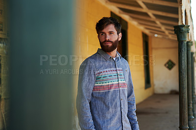 Buy stock photo Cropped shot of a handsome young man standing outside
