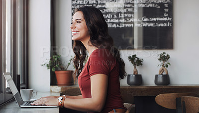Buy stock photo Cropped shot of a woman using her laptop in a coffee shop