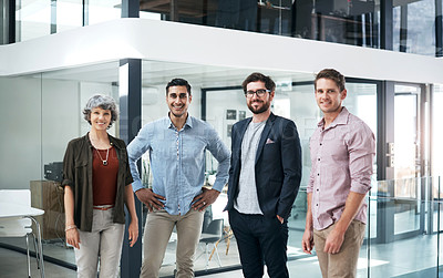 Buy stock photo Portrait of a confident group of businesspeople standing in a modern office