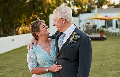Buy stock photo Shot of a happy senior couple posing together outdoors on their wedding day
