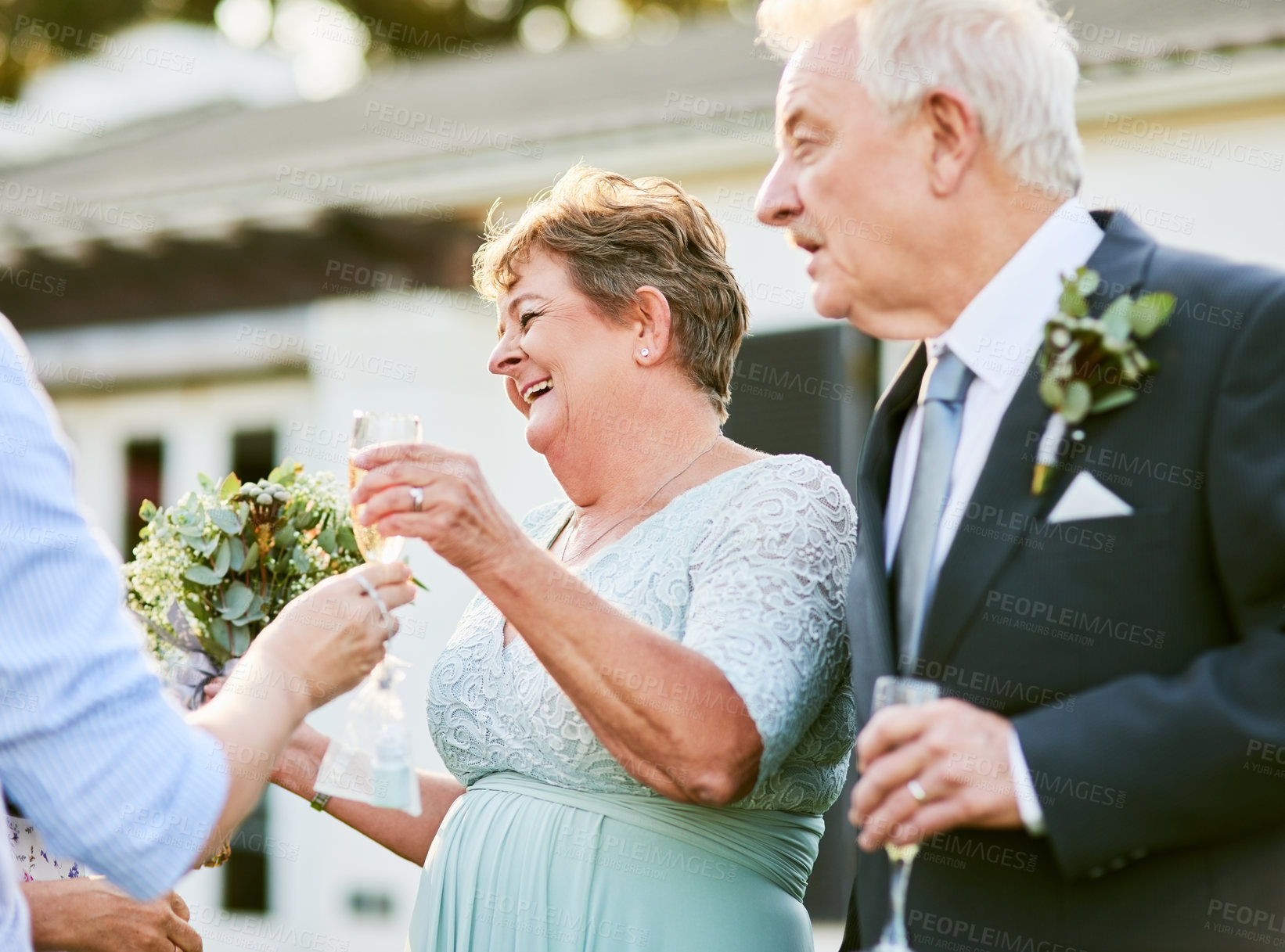 Buy stock photo Shot of a happy senior couple enjoying themselves outdoors on their wedding day