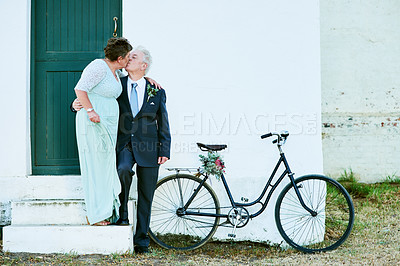 Buy stock photo Full length of a happy senior couple posing together outdoors on their wedding day