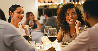Buy stock photo Cropped shot of a group of cheerful young friends having a chat while dining together in a restaurant