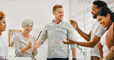 Buy stock photo Shot of a group of businesspeople clapping during a meeting in a modern office