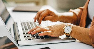 Buy stock photo Cropped shot of a businesswoman using a laptop in a modern office