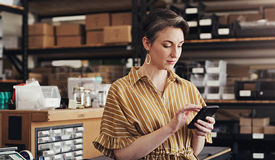 Buy stock photo Shot of a businesswoman using a digital tablet in a creative office