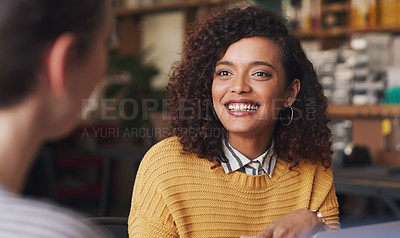 Buy stock photo Shot of two young businesswomen having a discussion in a creative office