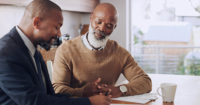 Buy stock photo Cropped shot of a senior man sitting with his financial advisor in his home during the day