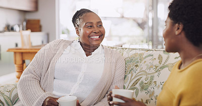 Buy stock photo Cropped shot of a happy senior woman sitting in the lounge with her daughter and enjoying a cup of coffee