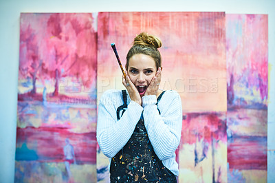 Buy stock photo Cropped portrait of an attractive young female painter looking shocked while standing in an art studio