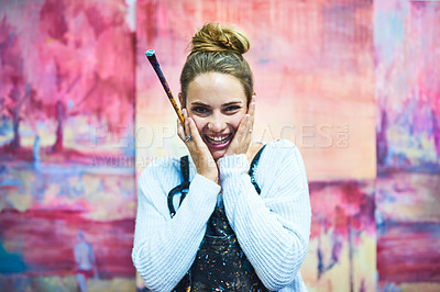 Buy stock photo Cropped portrait of an attractive young female painter smiling while standing in her art studio