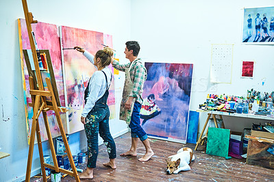 Buy stock photo Full length shot of a cheerful young couple painting together in an art studio