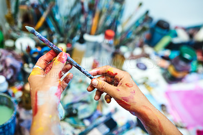 Buy stock photo Cropped shot of an unrecognizable female painter holding a paint brush in her art studio