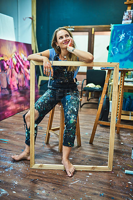 Buy stock photo Full length shot of an attractive young female painter smiling while looking away thoughtfully in her art studio