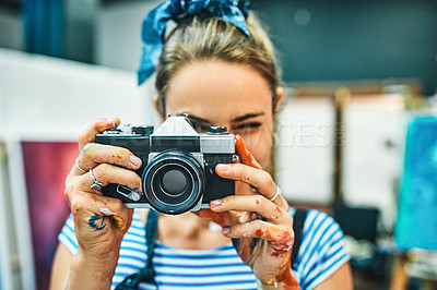 Buy stock photo Cropped portrait of an attractive young woman standing alone and using a camera to take pictures in her art studio