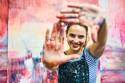 Buy stock photo Cropped portrait of an attractive young woman standing alone and feeling playful while posing in her art studio