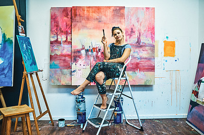Buy stock photo Full length portrait of an attractive young woman sitting on a ladder during a painting session in her art studio