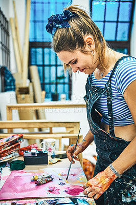 Buy stock photo Cropped shot of an attractive young woman mixing her paints for an art session in her studio