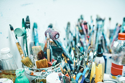Buy stock photo Cropped shot of an artist's busy workspace in an empty studio during the day