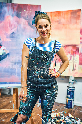 Buy stock photo Cropped portrait of an attractive young woman standing alone in her art studio during the day