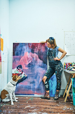 Buy stock photo Full length shot of an attractive young woman standing and posing with her dog next to her painting