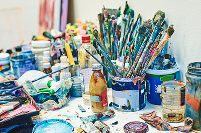 Buy stock photo Still life shot of paintings and paintbrush sets inside an art studio