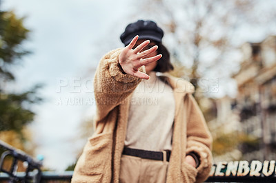 Buy stock photo Shot of a young woman making a stop gesture in the city