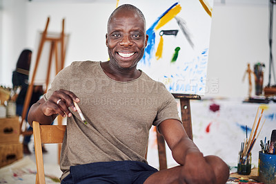 Buy stock photo Cropped shot of a middle aged man smiling at the camera in a art studio