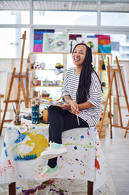 Buy stock photo Shot of a beautiful young woman smiling at the camera in a art studio