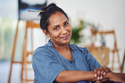 Buy stock photo Cropped shot of a beautiful young woman sitting in a art studio