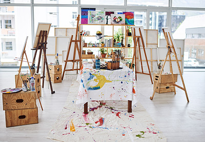 Buy stock photo Still life shot of easels and art supplies in a art studio