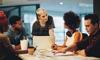 Buy stock photo Cropped shot of a group of young businesspeople discussing strategy during a meeting in their office