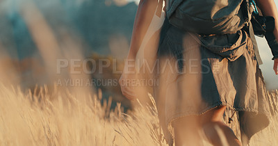 Buy stock photo Rearview shot of an unrecognisable woman out on a hike
