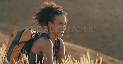 Buy stock photo Shot of a young woman taking a break while out on a hike