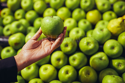 Buy stock photo Cropped shot of a woman shopping for apples in a grocery store