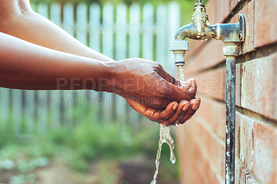 Buy stock photo Cropped shot of an unrecognizable woman washing her hands outdoors