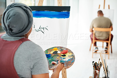 Buy stock photo Cropped shot of two unrecognizable artists sitting and painting on a canvas during a painting session in an art studio