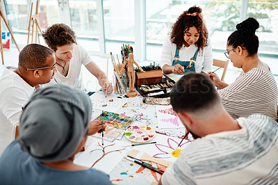 Buy stock photo Cropped shot of a diverse group of artists sitting together and painting during an art class in a studio