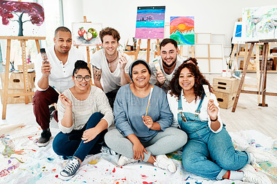 Buy stock photo Full length portrait of a diverse group of friends posing together during an art class in the studio