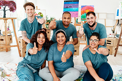 Buy stock photo Cropped portrait of a diverse group of friends posing together and showing a thumbs up after an art class