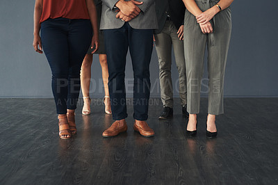 Buy stock photo Studio shot of an unrecognizable group of businesspeople standing against a grey background