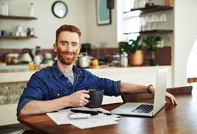Buy stock photo Portrait of a young man drinking coffee while going through paperwork at home