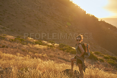 Buy stock photo Portrait of an attractive young woman hiking out in the mountains on a sunny day