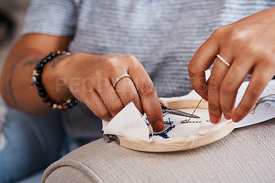 Buy stock photo Cropped shot of an unrecognizable woman doing embroidery at home