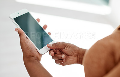 Buy stock photo Cropped shot of an unrecognizable businesswoman using her smartphone inside of an office